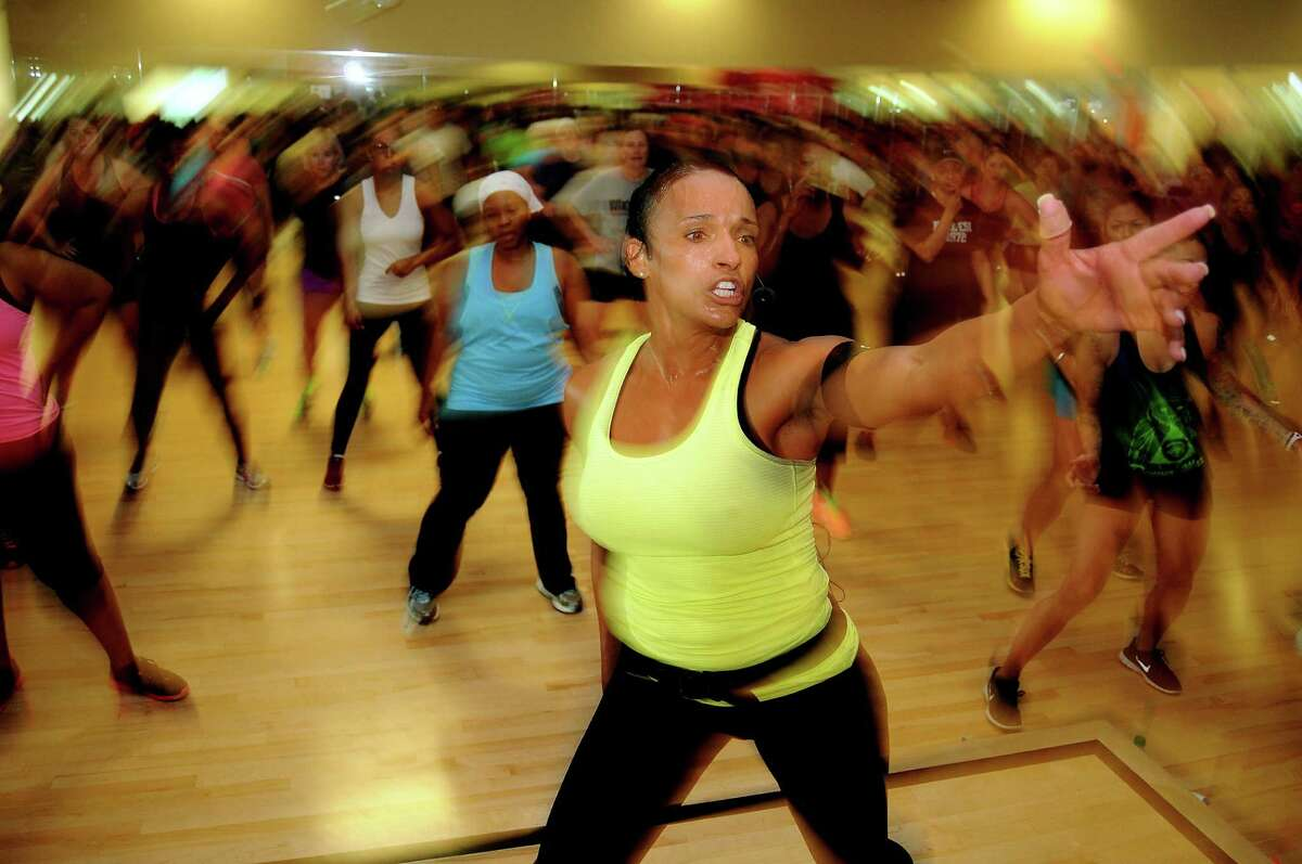 Tammy Harris leads her hugely popular Soul Grooves class at Life Time Fitness on Will Clayton Parkway Saturday July 12, 2014. (Dave Rossman photo)