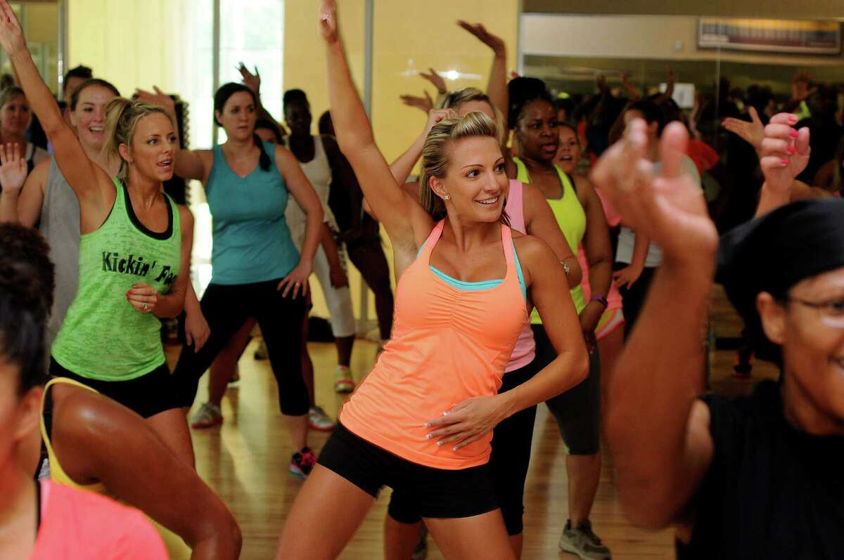 Students work up a sweat in Tammy Harris' hugely popular Soul Grooves class at Life Time Fitness in Humble, Texas, on July 12, 2014.