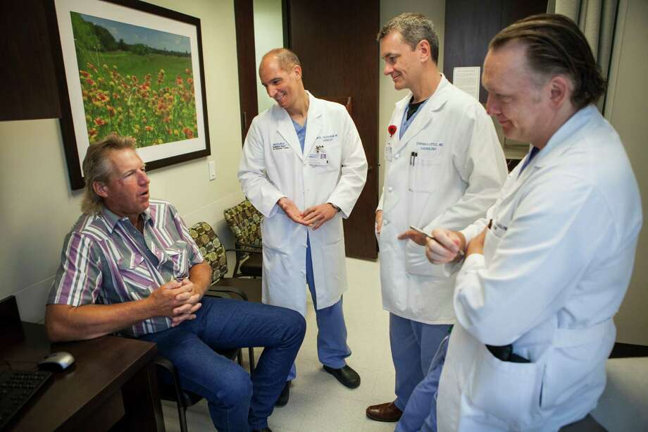 William Maxwell, left, of Livingston, TX, speaks with his team of doctors, from left to right, Dr. Miguel Valderrábano, Dr. Stephen H. Little, and Dr. Colin M. Barker, during a post-op appointment at Houston Methodist in Houston, TX on Monday June 9, 2014. Mr. Maxwell was able to avoid a second open-heart surgery by having an unusual repair to a heart valve. (Scott Dalton/Chronicle) Photo: Scott Dalton, Freelance / 2014 Houston Chronicle