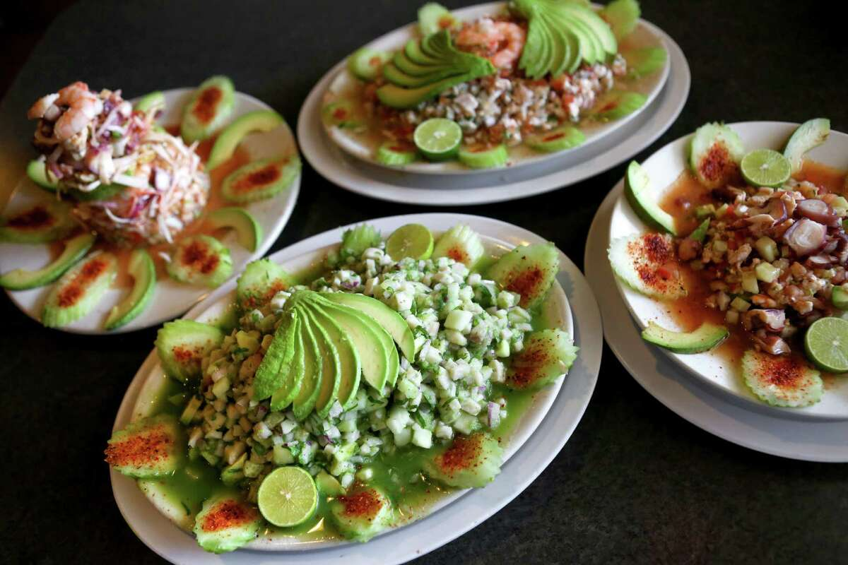 From left: Torre de Mariscos (seafood tower), ceviche verde (front), fish and shrimp ceviche (rear), shrimp and octopus ceviche (right)