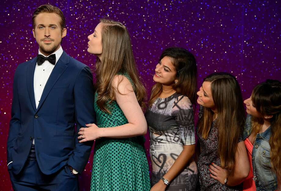 No matter how passionately these lovely ladies kiss Ryan Gosling, the Canadian actor remains immune to their advances. Mainly because he's made of wax. (Madame Tussauds, London.) Photo: Jonathan Short, Associated Press
