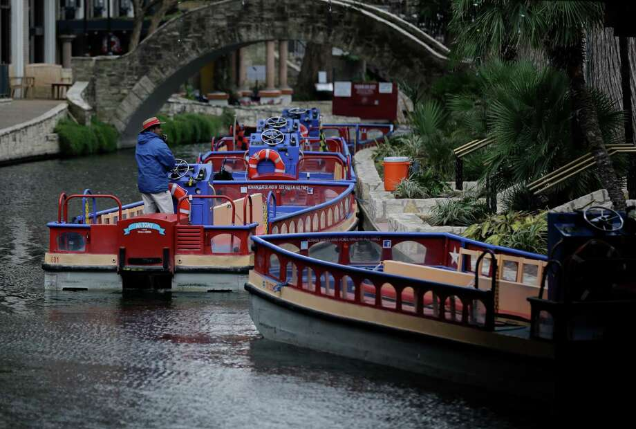FILE PHOTO — A row of empty river boats are seen along the River Walk, Monday, Jan. 27, 2014, in San Antonio. Cooler weather began blowing into the area Monday as freezing temperatures are expected to return to the region. Photo: Associated Press / AP