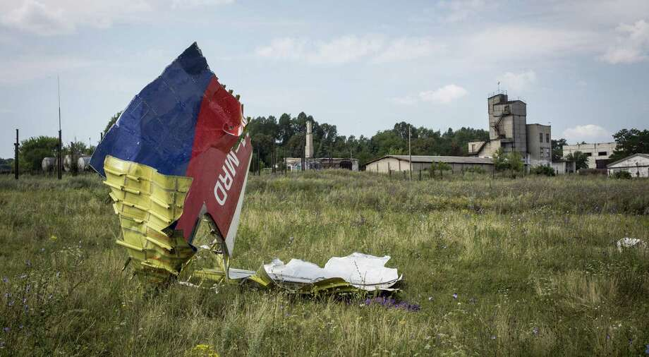 Wreckage from Malaysia Airlines Flight 17 lies in a field in Ukraine. Regardless of who pulled the trigger, Russia is to blame for providing weapons to nonstate groups. Photo: Rob Stothard / Getty Images / 2014 Getty Images