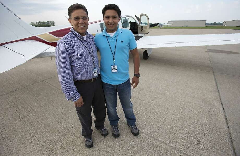 Babar Suleman and son Haris, 17, prepare for their around-the-world flight June 19 in Greenwood, Ind. They had a goal of circling the globe in 30 days. Their plane went down after takeoff from Pago Pago. Photo: Robert Scheer, Associated Press