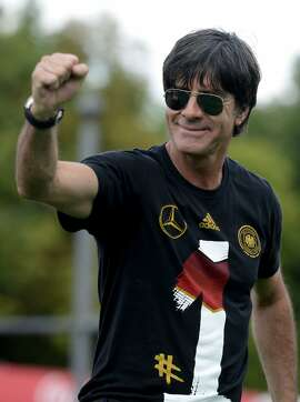 (FILES) This photo taken on July 15, 2014 shows Germany's coach Joachim Loew during a victory parade of Germany's football national team in Berlin. Loew will recieve a honorary citizenship of his birth village Schoenau, the municipality annaounced on July 22. Germany won their fourth World Cup title, after their 1-0 win over Argentina on July 13, 2014 in Rio de Janeiro in the FIFA World Cup Brazil final game.   AFP PHOTO / CLEMENS BILANCLEMENS BILAN/AFP/Getty Images