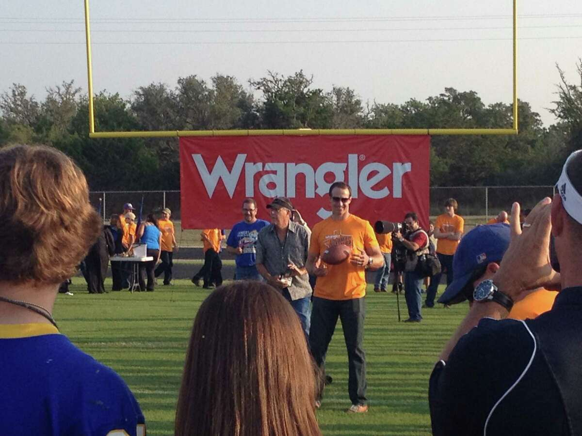 Drew Brees, honorary Mayor of Comfort, Texas, hangs with fans at Comfort High School on July 23, 2014 for an event hosted by Wrangler.