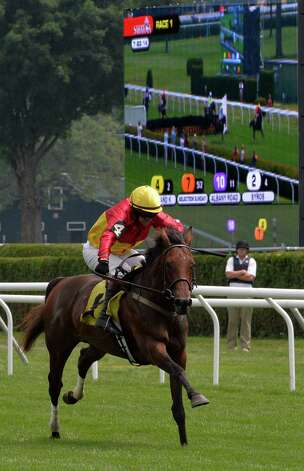 Rudyard K with jockey Ross Geraghty completed the final fence and goes on to win the two-and-one-sixteenth-mile steeplechase race Wednesday afternoon July 23, 2014 at the Saratoga Race Course in Saratoga Springs. Photo: SKIP DICKSTEIN, ALBANY TIMES UNION