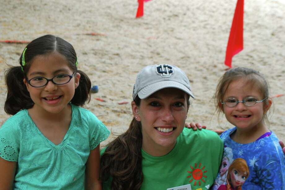 Emma Chavez and Grace Lombardo, shown with camp counselor Jessica Milsom, are two of 32 children with special needs who are participating in New Canaan YMCAís Camp Y-Ki this summer. Photo: Contributed Photo, Contributed / New Canaan News Contributed
