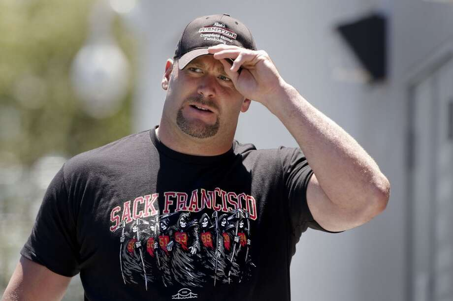 Justin Smith, (94) wears a tee shirt showing their defensive line as the San Francisco 49ers' veterans reported to training camp today for the 2014 season at their practice facility in Santa Clara, Calif., as seen on Wednesday July 23, 2014. Photo: Michael Macor, The Chronicle