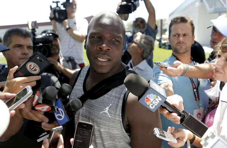 Running back Frank Gore, (21) talks with the news media as the San Francisco 49ers' veteran players reported to training camp today to prepare for the 2014 season at their practice facility in Santa Clara, Calif., as seen on Wednesday July 23, 2014. Photo: Michael Macor, The Chronicle