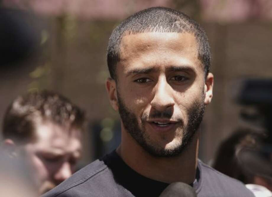Quarterback Colin Kaepernick, (7) talks with the news media as the San Francisco 49ers' veteran players reported to training camp today to prepare for the 2014 season at their practice facility in Santa Clara, Calif., as seen on Wednesday July 23, 2014. Photo: Michael Macor, The Chronicle
