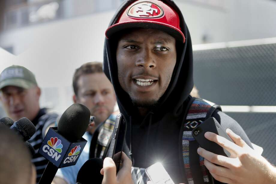 Wide receiver Stevie Johnson, (13) talks with the news media as the San Francisco 49ers' veteran players reported to training camp today to prepare for the 2014 season at their practice facility in Santa Clara, Calif., as seen on Wednesday July 23, 2014. Photo: Michael Macor, The Chronicle