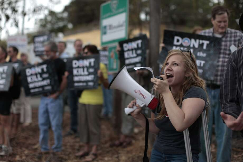 April Glaser protests about net neutrality on Page Mill Road. (2014) Photo: James Tensuan, The Chronicle