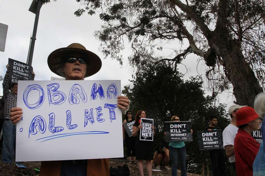 Russell Blalack protests about net neutrality. (2014) Photo: James Tensuan, The Chronicle