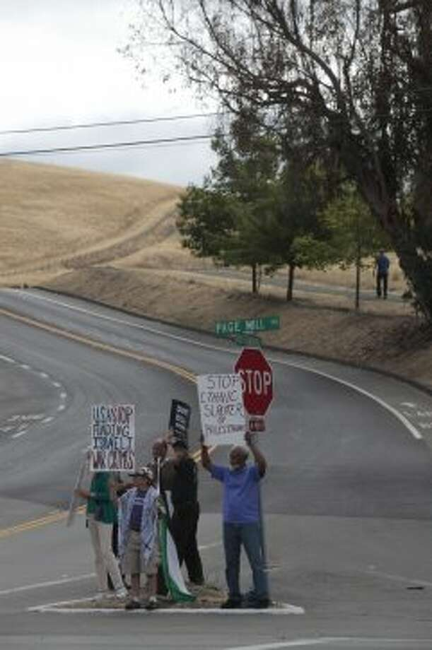 Protesters for various causes gather at Page Mill Road on Wednesday. Photo: James Tensuan, The Chronicle