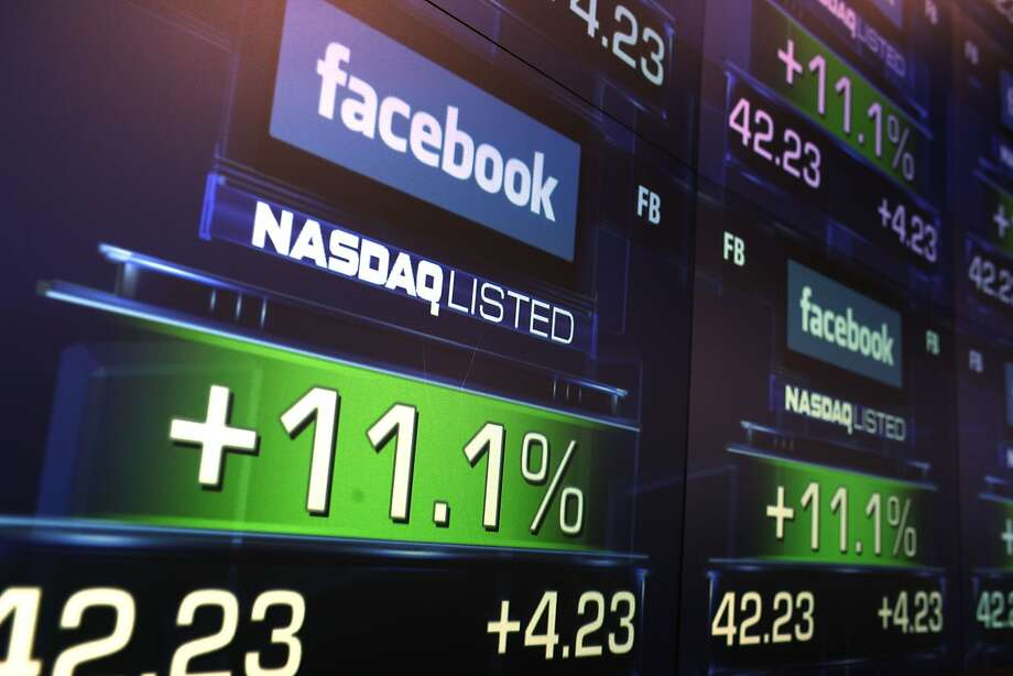 FILE - JULY 23:  According to reports July 23, 2014, Facebook Inc. sales rose to $2.91 billion in the second quarter, compared to $1.8 billion last year, topping the average analyst estimate of $2.81 billion. NEW YORK, NY - MAY 18: The share price of newly debuted Facebook stock is seen at the Nasdaq stock market moments after it went public on May 18, 2012 in New York, United States. The social network site began trading after 11:30 a.m. with shares jumping 13% to $43 before quickly falling. On Thursday Facebook priced 421 million shares at $38 each. Facebook, a Menlo Park, California based company, will have a valuation exceeding $100 billion.  (Photo by Spencer Platt/Getty Images) Photo: Spencer Platt, Getty Images