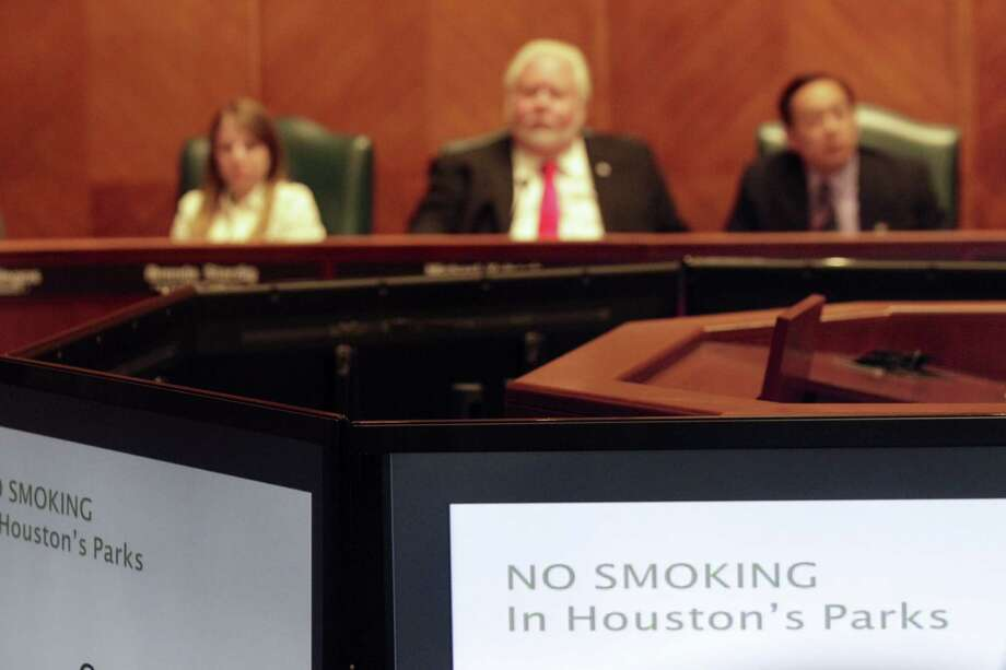 Houston city parks soon will be smoke-free and a ban already in place at libraries will be expanded to include all outdoor library property, staff announced at a city meeting Wednesday, July 23, 2014. Photo: Johnny Hanson / Houston Chronicle