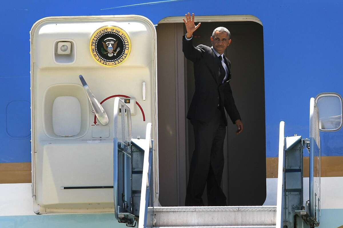 President Obama waves as he boards Air Force One before departing from San Francisco International Airport in San Francisco, CA, Wednesday, July 23, 2014.
