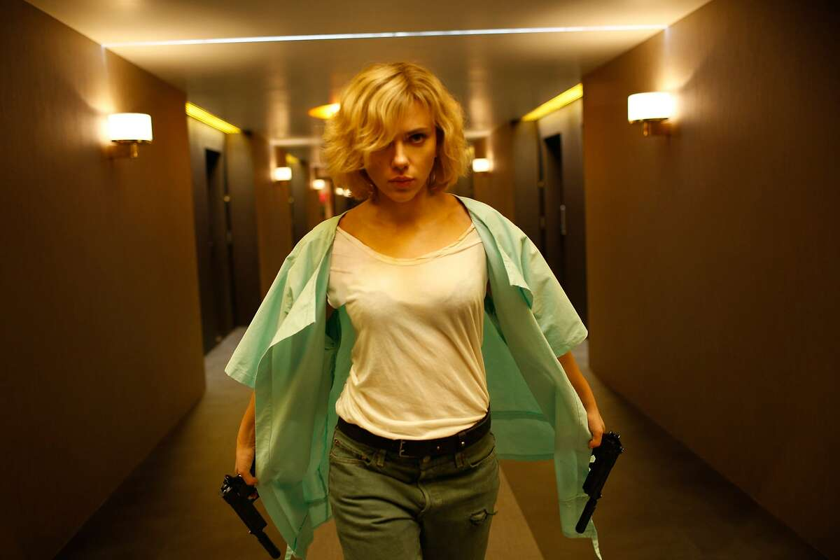 """Lucy (SCARLETT JOHANSSON) is temporarily held hostage by thugs in """"Lucy"""", an action-thriller that examines the possibility of what one human could truly do if she unlocked 100 percent of her brain capacity and accessed the furthest reaches of her mind."""