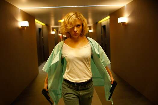 """LucyRotten Tomatoes: 63 percentReview by Mick LaSalle: 'Lucy' review: Straight-up action with serious brains4 starsLike some demented combination of """"Taken"""" and Terrence Malick's """"The Tree of Life,"""" """"Lucy,"""" the latest from Luc Besson, is a full-out action movie - and a sober rumination on the nature of existence. It is both things, effectively and sincerely. Photo: Jessica Forde, Universal Pictures"""