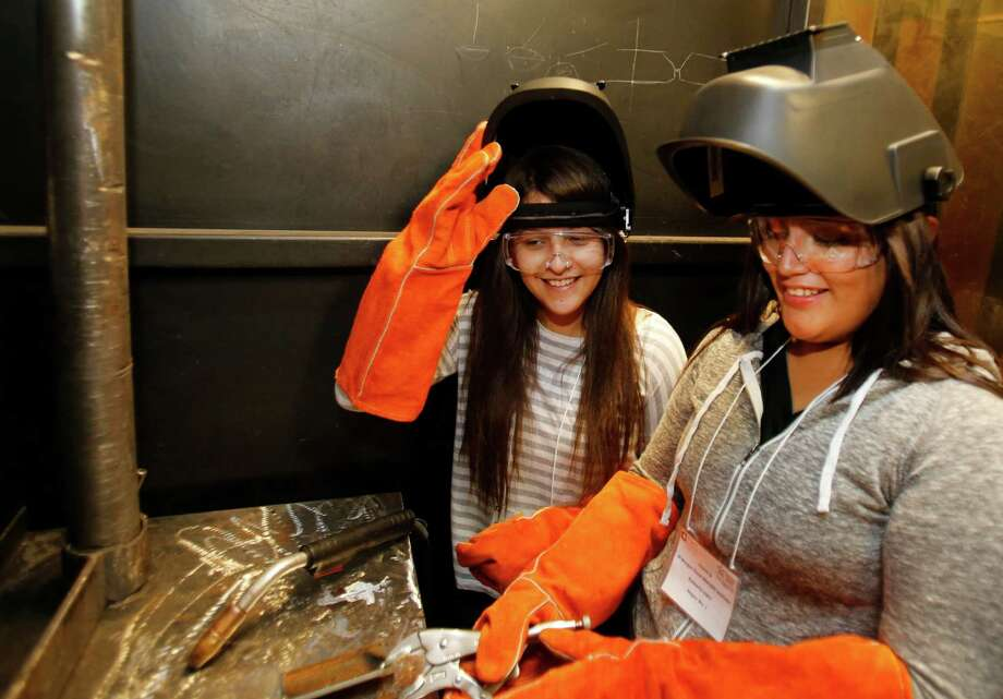 Juana Granagos, left, a senior at Sam Houston High School, and Kimberly Lopez, a senior  at Reagan High School, took part in Project GRAD, which prepares teenagers for careers. Photo: Melissa Phillip, Staff / © 2014  Houston Chronicle