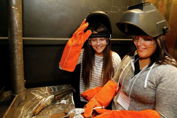 Juana Granagos, left, a senior at Sam Houston High School, and Kimberly Lopez, a senior  at Reagan High School, took part in Project GRAD, which prepares teenagers for careers.