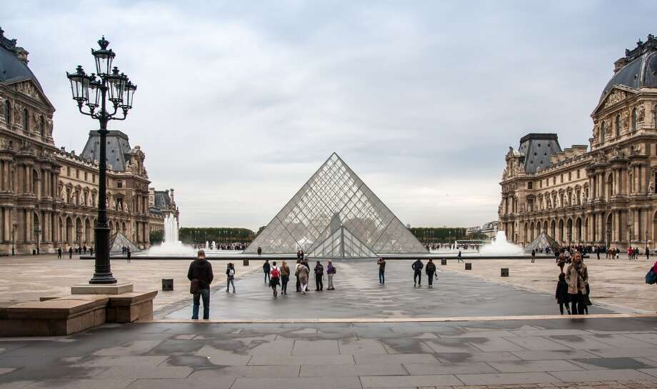 """Paris:Cultural attractions such as the Louvre (pictured) made it hard for some SFGate readers to believe that the City of Light did not make Travel+Leisure's 2014 World's Best Cities Top 10 list. """"Epic algorithm fail,"""" wrote commenter caloldblue. Fellow reader leoleo called it the """"loveliest city in the world,"""" while raffy, who claims to have visited """"over three dozen times since my first trip in 2000,"""" called Paris simply """"awesome."""" Photo: Jean-François Gornet,"""