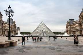 "Paris: Cultural attractions such as the Louvre (pictured) made it hard for some SFGate readers to believe that the City of Light did not make Travel+Leisure's 2014 World's Best Cities Top 10 list. ""Epic algorithm fail,"" wrote commenter caloldblue. Fellow reader leoleo called it the ""loveliest city in the world,"" while raffy, who claims to have visited ""over three dozen times since my first trip in 2000,"" called Paris simply ""awesome."""