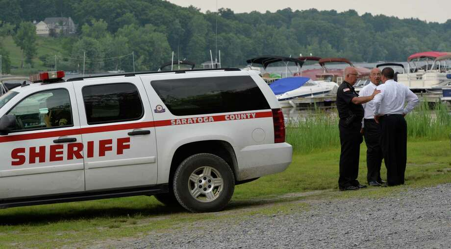 Members of the Saratoga County Sheriff's office gather on the side of Saratoga Lake to investigate a drowning at Lee's Park Wednesday afternoon July 23, 2014  in Saratoga Springs, N.Y.      (Skip Dickstein / Times Union) Photo: SKIP DICKSTEIN