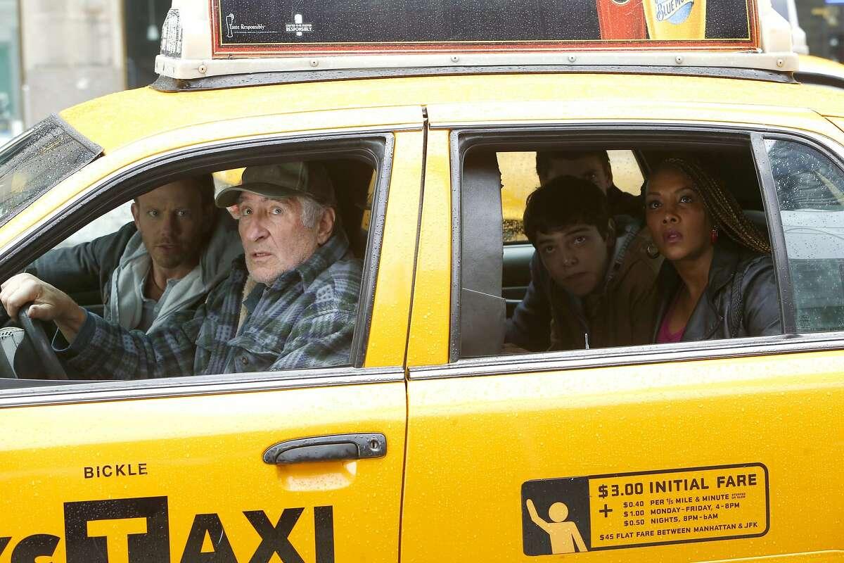 Ian Ziering as Fin Shepard (left), Dante Palminteri as Vaughn Brody, Vivica A. Fox as Skye take a taxi in SyFy's sequel,
