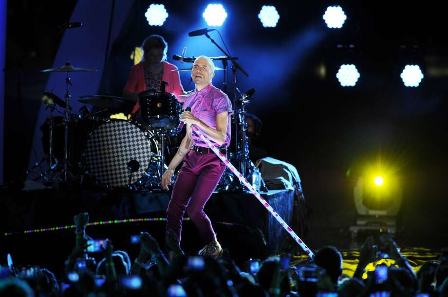 Tyler Glenn of Neon Trees performs at the iHeartRadio Ultimate Pool Party at Fontainebleau's BleauLive at Fontainebleau Miami Beach on June 28, 2014 in Miami Beach, Fla. (Photo Jeff Daly/Invision/AP) Photo: Jeff Daly, Associated Press