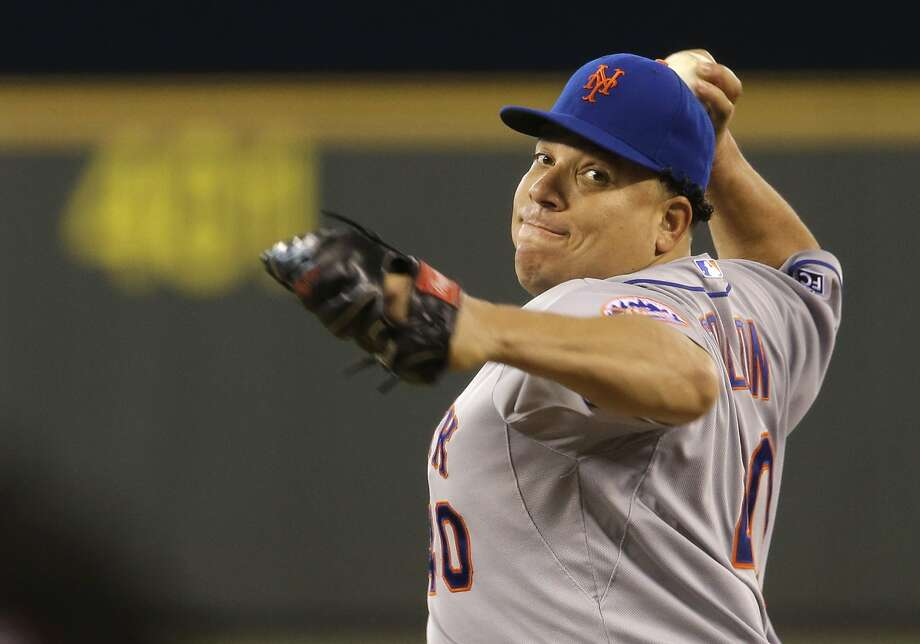 New York Mets starting pitcher Bartolo Colon throws against the Seattle Mariners in the fifth inning of a baseball game on Wednesday, July 23, 2014, in Seattle. (AP Photo) Photo: Associated Press