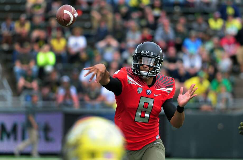 The annual media preseason poll predicted Marcus Mariota and the Oregon Ducks to win the conference title this season. Photo: Steve Dykes, Getty Images