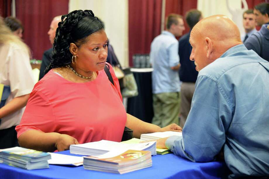 Alicia Bynum of Albany speaks with Rick Rose from Capital Region BOCES Adult Health Careers during the Times Union Job Fair at the Albany Marriott Wednesday, July 23, 2014, in Colonie, N.Y.  (John Carl D'Annibale / Times Union) Photo: John Carl D'Annibale / 00027884A