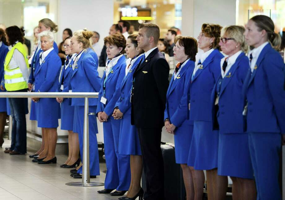 Stewards and stewardesses hold a minute's silence at Schiphol Airport on July 23, 2014, to commemorate the victims of the air crash of Malaysia Airlines flight MH17.  Photo: OLAF KRAAK, AFP/Getty Images / AFP