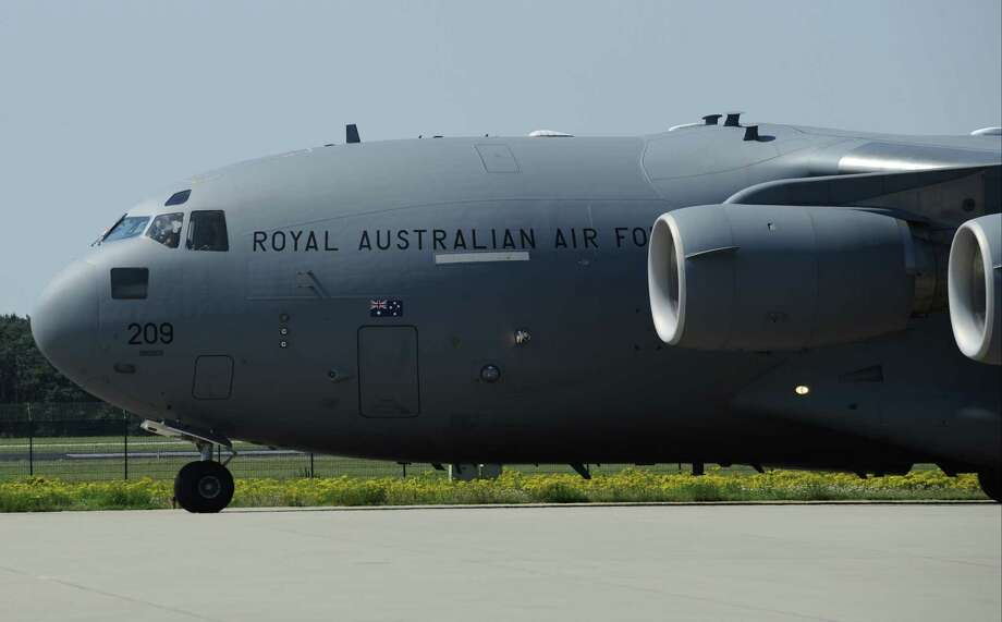 A Royal Australian Air Force C-17 transport plane, which carries coffins containing the remains of victims of downed Malaysia Airlines flight MH17,  is seen after landing coming from Ukraine, and prior to a ceremony at Eindhoven Airbase on July 23, 2014. The first bodies from flight MH17 arrived in the Netherlands on July 23 almost a week after it was shot down over Ukraine, with grieving relatives and the king and queen of The Netherlands solemnly receiving the as yet unidentified victims.  Photo: JOHN THYS, AFP/Getty Images / AFP