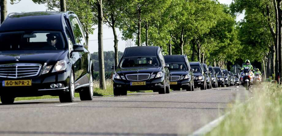 The convoy of hearses carrying coffins containing the remains of victims of the downed Malaysia Airlines flight MH17 drive near  Hilversumafter leaving the Eindhoven Airbase to Hilversum on July 23, 2014, following a ceremony following the arrival of a Dutch Air Force C-130 Hercules plane and an Australian Royal Australian Air Force C17 transport plane with the first bodies of the 298 victims of the Malaysia Airlines MH17 plane crash in eastern Ukraine. Photo: SANDER KONING, AFP/Getty Images / AFP