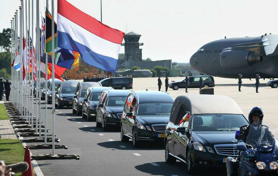 Hearses carry coffins containing unidentified bodies from the crash of Malaysia Airlines flight MH17 on July 23, 2014 in Eindhoven, Netherlands.  Photo: Peter Macdiarmid, Getty Images / 2014 Getty Images