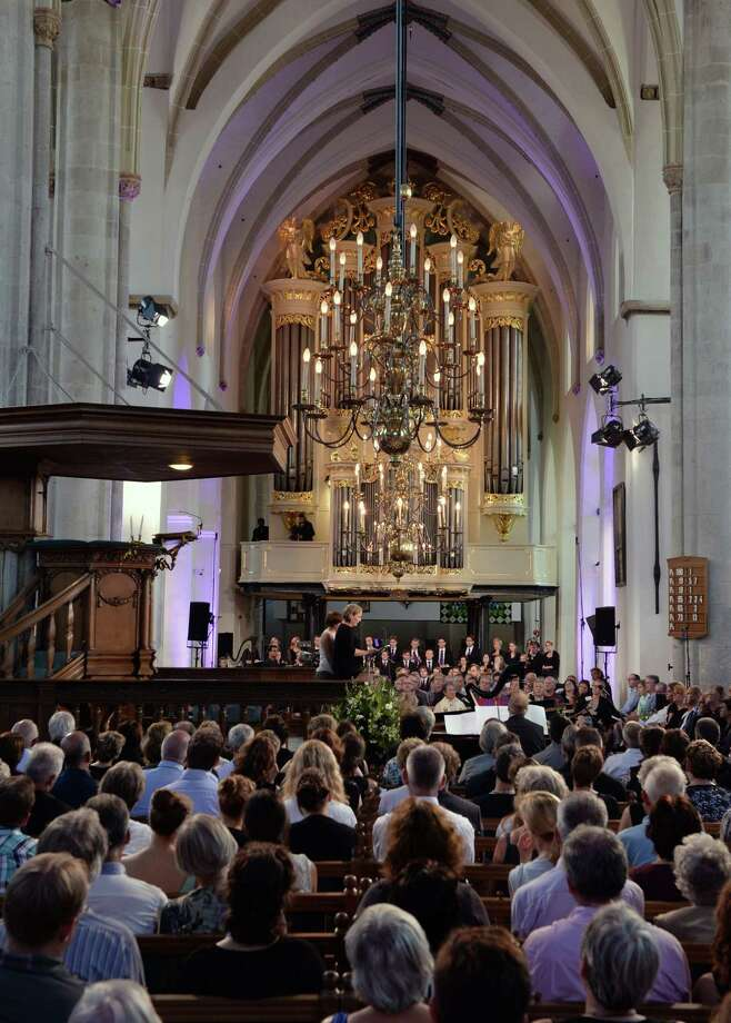 People attend a service in memory of the 298 victims of the the downed Malaysia Airlines flight MH17 on July 23, 2014 at the Joriskerk church in Amersfoort.  Photo: PIROSCHKA VAN DE WOUW, AFP/Getty Images / AFP