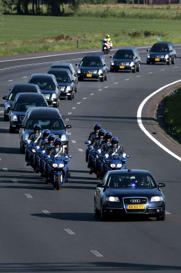 The convoy of hearses carrying coffins containing the remains of victims of the downed Malaysia Airlines flight MH17 drive near Culemborg after leaving the Eindhoven Airbase to Hilversum on July 23, 2014, following a ceremony following the arrival of a Dutch Air Force C-130 Hercules plane and an Australian Royal Australian Air Force C17 transport plane with the first bodies of the 298 victims of the Malaysia Airlines MH17 plane crash in eastern Ukraine.  Photo: OLAF KRAAK, AFP/Getty Images / AFP