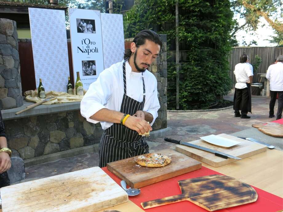 Chef Chiarello's pizza being served up to reception guests. Photo: Catherine Bigelow