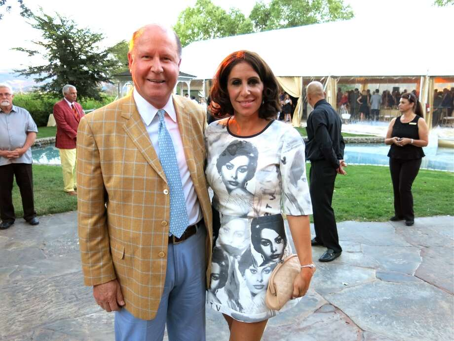 John and Lisa Grotts, who sported a dress adorned with images of Loren. Photo: Catherine Bigelow