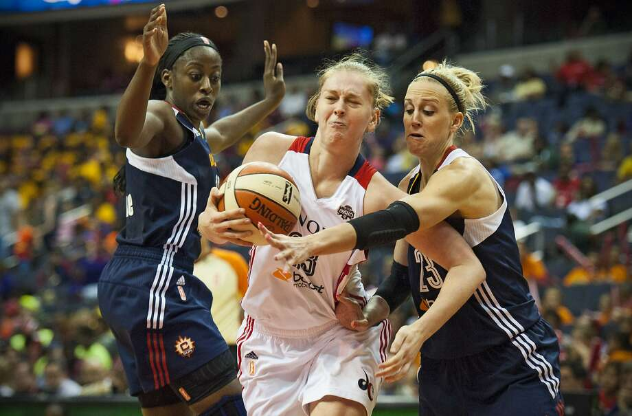 Washington center Emma Meesseman fights through the defense of Connecticut's Chiney Ogwumike (left) and Katie Douglas. Photo: Katherine Frey, Associated Press