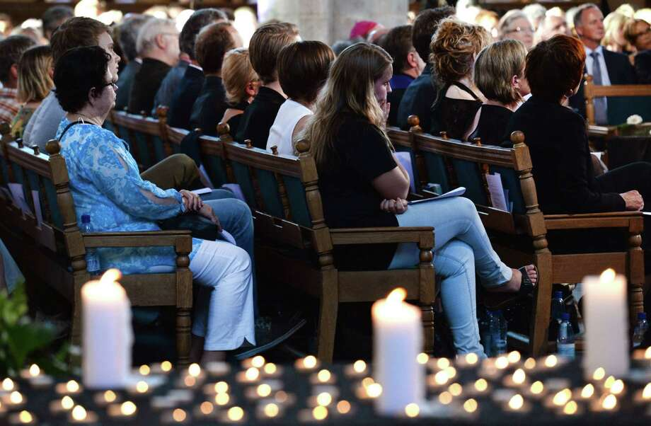 People attend a service in memory of the 298 victims of the the downed Malaysia Airlines flight MH17 on July 23, 2014 at the Joriskerk church in Amersfoort. The first bodies from flight MH17 arrived in the Netherlands on Wednesday almost a week after it was shot down over Ukraine, as the conflict flared yet again near the Malaysian airliner's crash site.  Photo: PIROSCHKA VAN DE WOUW, AFP/Getty Images / AFP