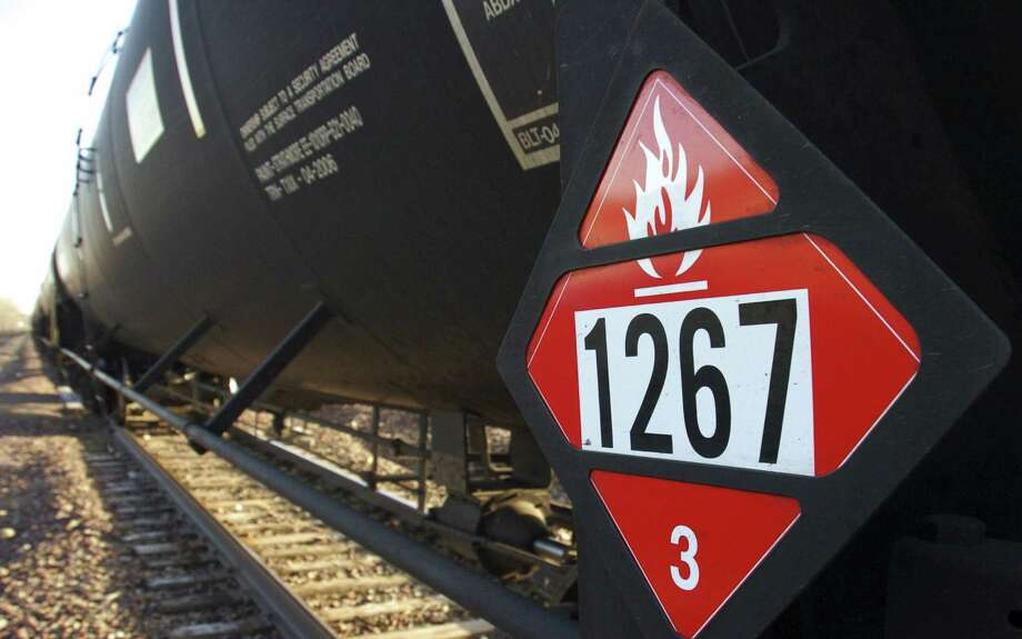 Federal regulators proposed phasing out older tank cars and lowering speed limits as part of a set of new rules intended to reduce the risks of hauling crude oil by rail. Photo: Associated Press / AP