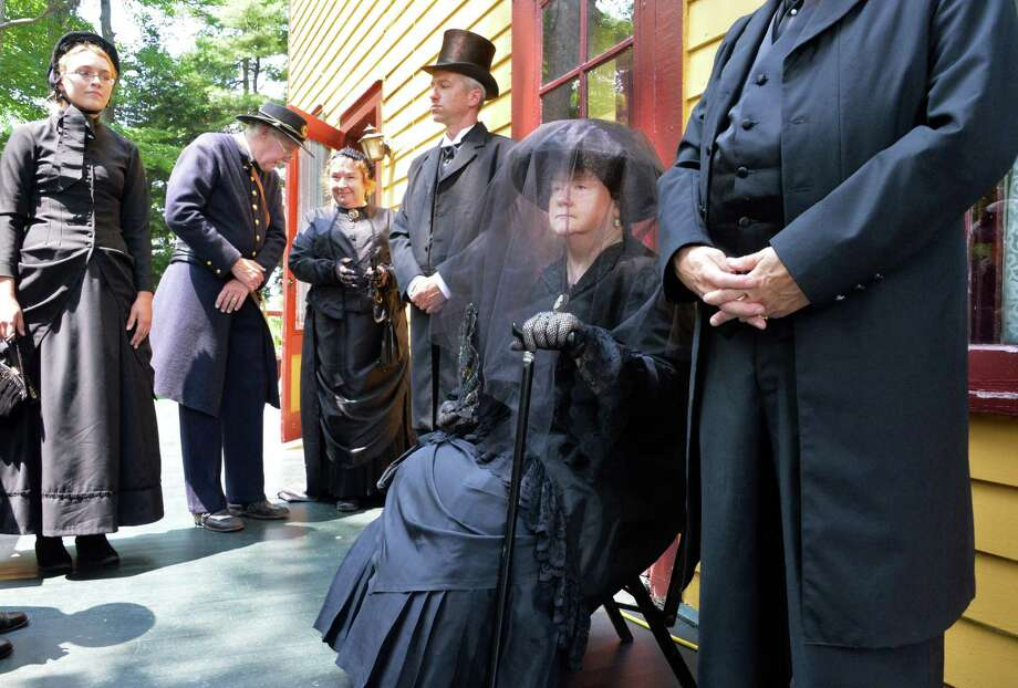 Dressed as Julia Grant, widow of President Ulysses S. Grant, Kathleen Cummings, center, and other reenactors await the start of Ulysses S. Grant Remembrance Day Wednesday July 23, 2014, at Grant's Cottage in Wilton, N.Y.  (John Carl D'Annibale / Times Union)) Photo: John Carl D'Annibale / 00027767A