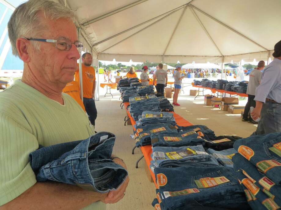 Bill Vernor and other residents of 'Advanced Comfort' received a free pair of Wrangler jeans and a T-shirt on Wednesday. Photo: Zeke MacCormack / San Antonio Express-News