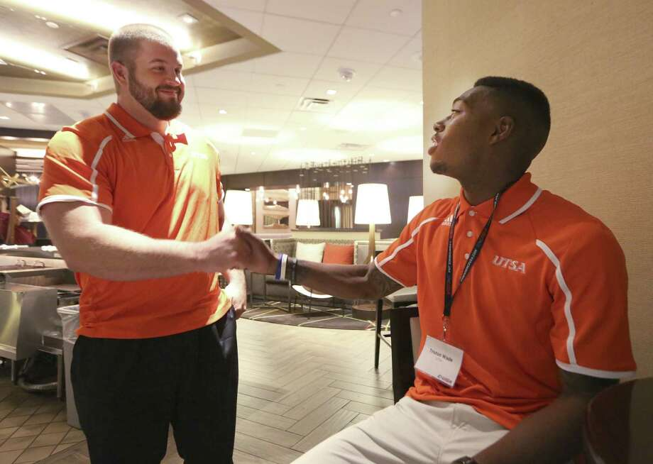 "Scott Inskeep (left), with safety Triston Wade at C-USA media days, says the rising Roadrunners need to ""stay humble with it."" Photo: Associated Press / AP"