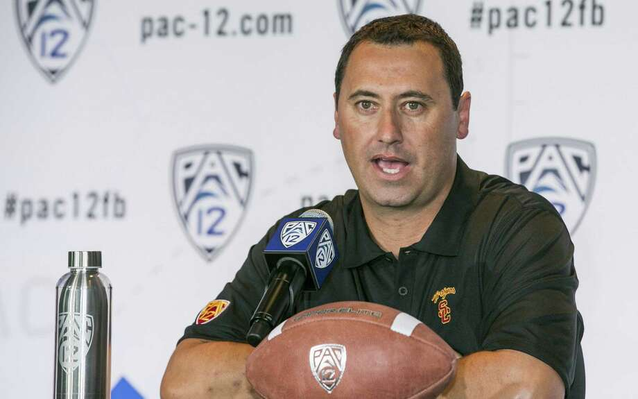 Southern Cal coach Steve Sarkisian, who left Washington after last season, thinks the Trojans can contend for the league title. Photo: Associated Press / AP