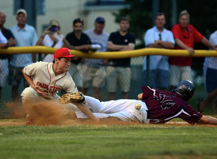 Fairfield American's P.J. Egan fails to tag out Farmington's Jacob Conrad at third, during little league sectional tournament action at Old Tavern Park in Orange, Conn. on Wednesday July 23, 2014. Photo: Christian Abraham / Connecticut Post